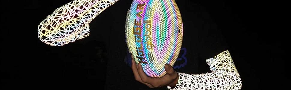 kid holding football wearing holographic glowing sleeves